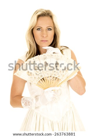 a woman with a sensual expression on her face, holding a fan. - stock photo