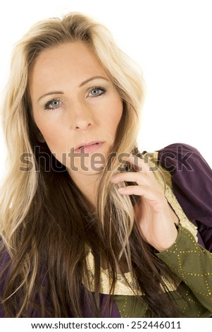 a woman with a serious expression on her face in her vintage dress. - stock photo