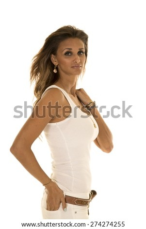 a woman with a serious expression on her face, in her white tank. - stock photo