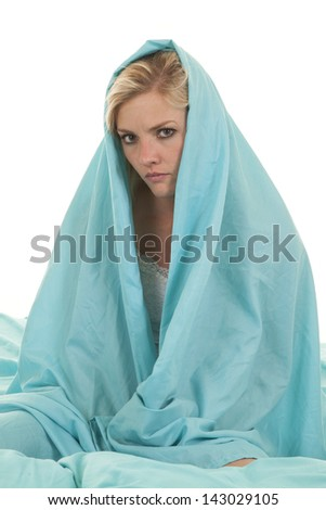 a woman with a sheet wrapped around her head with a serious expression