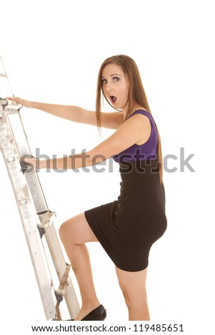 A woman with a shocked expression on her face climbing the ladder to success either in school or work. - stock photo