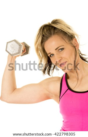A woman with a small smile, working out her arm by doing a curl. - stock photo