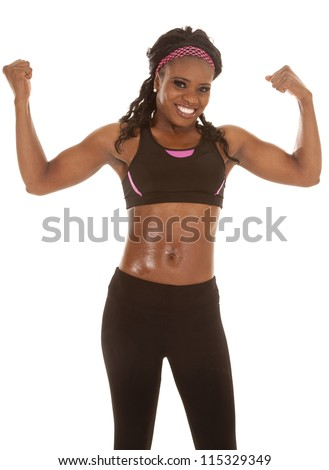 A woman with a smile on her face flexing her arms - stock photo