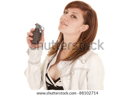 A woman with a smile on her face holding a grenade up close to her face. - stock photo