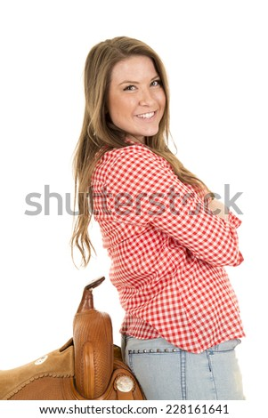 a woman with a smile on her face leaning back on her saddle - stock photo