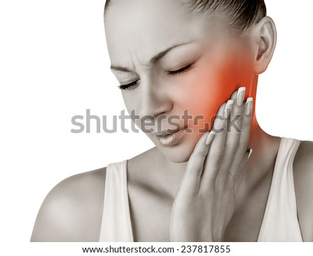 A woman with a toothache isolated on white background - stock photo