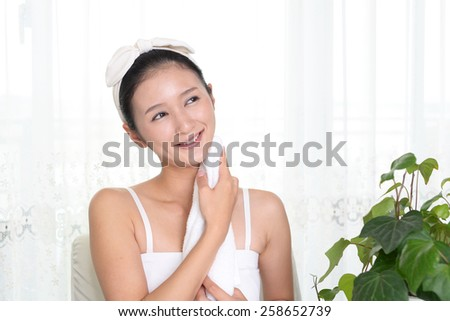 A woman with a towel - stock photo