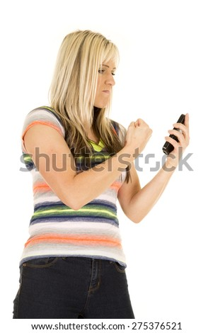 a woman with an upset expression on her face, wanting to punch her phone. - stock photo