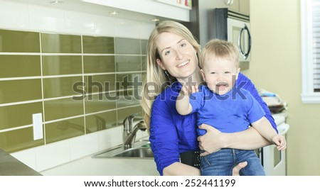 A Woman with Boy on the kitchen - stock photo
