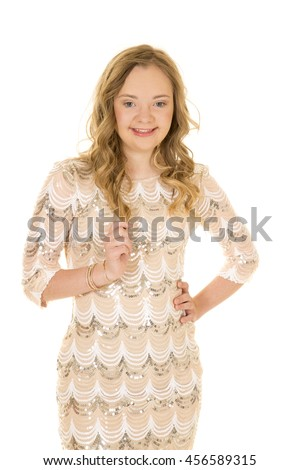 A woman with down syndrome in her dress, with her hand on her hip, with a smile.