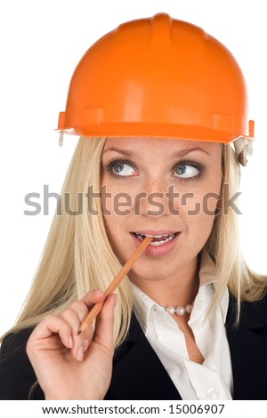 A woman with freckles in hard hat - stock photo
