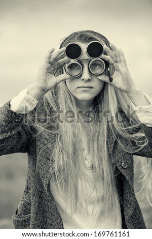 a woman with goggles black and white photography