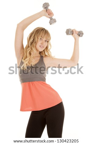 A woman with her arms up and holding on to weights with a small smile on her lips.
