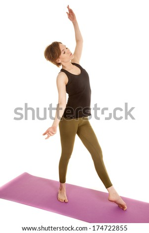 a woman with her eyes closed stretching her body while doing dance moves. - stock photo