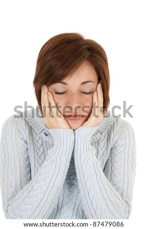 A woman with her head in her hands trying to catch some sleep.