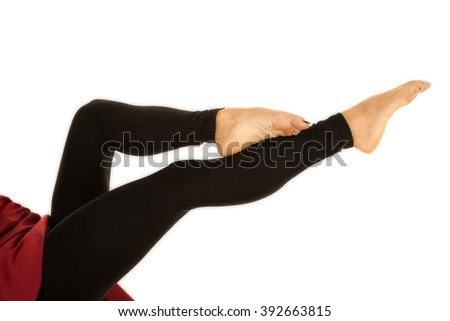 A woman with her legs stretched out and toes pointed.