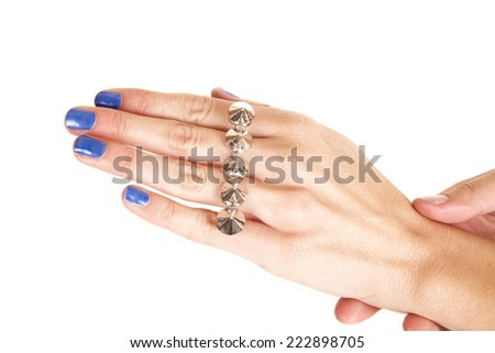 a woman with her silver knuckle ring on her fingers.