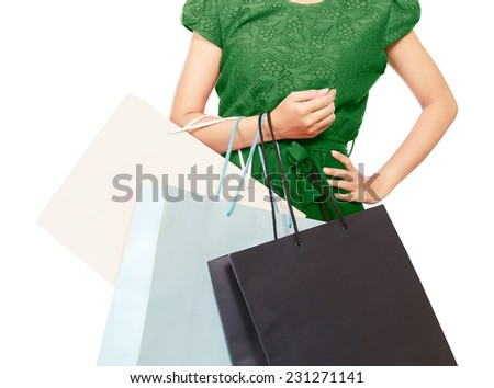 a woman with lots of shopping bags, isolated on white background - stock photo