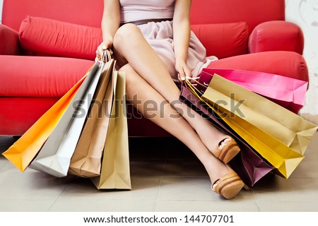 A woman with many shopping bags. - stock photo