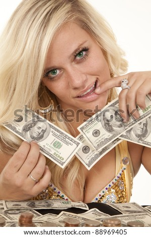 A woman with money in her hands counting how much she has. - stock photo