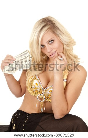 A woman with money in her hands with a small smile on her face. - stock photo