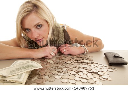 A woman with money on the table in front of her. - stock photo