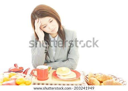 A woman with no appetite. - stock photo
