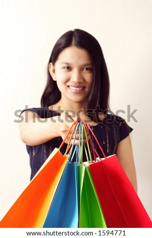 A woman with shopping bags (shallow DOF, focus on hand)