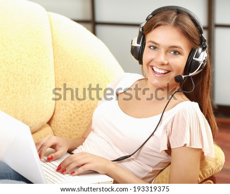 A woman working on a laptop - stock photo