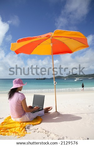 A woman working on the beach in Whitsunday island