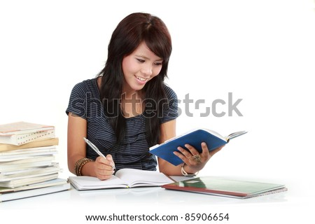 a woman writing in a book - stock photo
