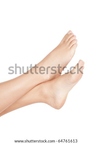 A womans bare legs up in the air. - stock photo