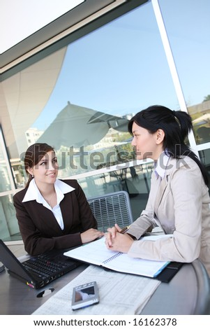 A women business team at their company office building - stock photo