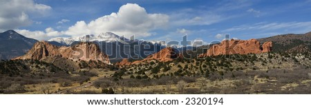 A wonderful panorama showing the red rocks of the Garden of the Gods and a snow-covered Pikes Peak. - stock photo