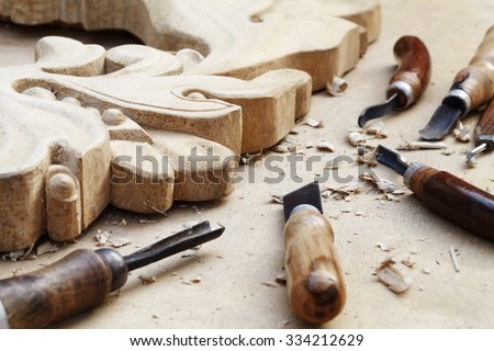 a wood carvings, tools and processes work closeup - stock photo