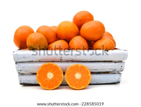 A wood crate full of Clementine Mandarin Oranges.  - stock photo