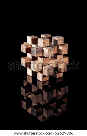 A wood made puzzle - stock photo