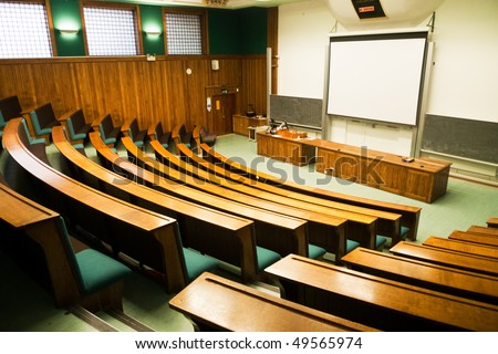 A wood panelled university lecture theatre/conference hall - stock photo