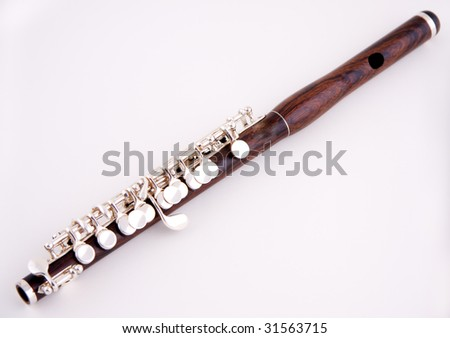 A wood piccolo isolated against a white background in the horizontal format with copy space. - stock photo