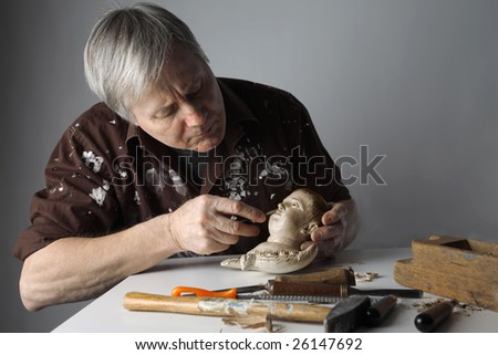 a wood sculptor - stock photo