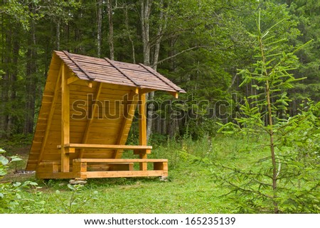 A wooden arbor in forest - stock photo