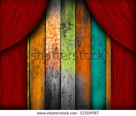 A wooden background behind a red curtain - stock photo