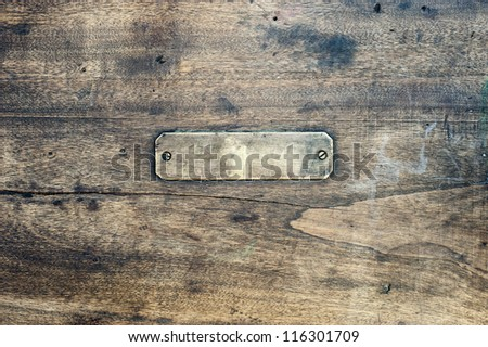 A Wooden background with a metal label - stock photo