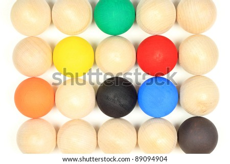 A wooden balls most in natural wooden colour and others paint in different colours all in focus, representing diversity in the society, nature and life.