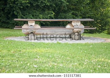 A wooden bench in a park near Vevey, Switzerland - stock photo