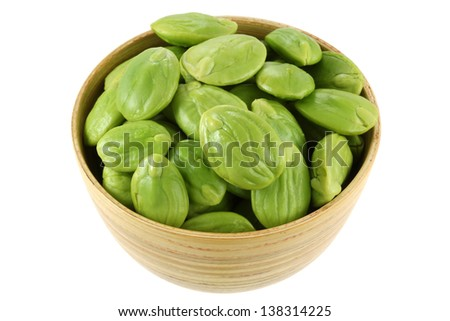 A wooden bowl of Stink Bean, also called Parkia speciosa, Bitter bean, isolated on white background