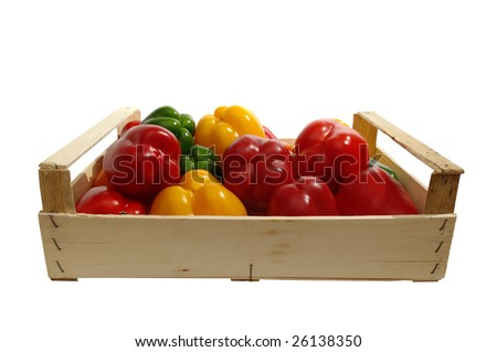 a wooden box with paprika is on white background