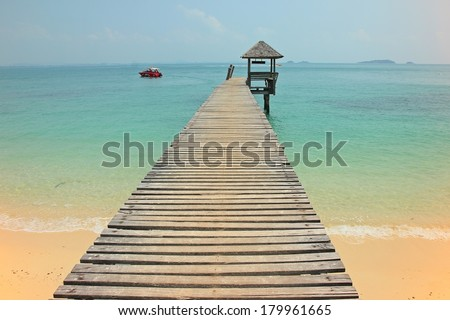 A wooden bridge leading to a wooden pavilion over the sea at Koh Samet island Thailand  - stock photo