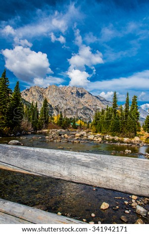 A wooden bridge over a river in Grand Teton National Park, WY.