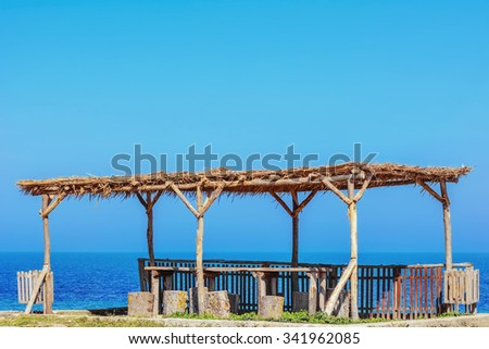 A wooden canopy on the Shore of the Black Sea - stock photo